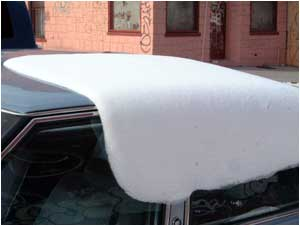 snow like icing sliding off car top
