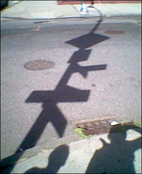 sign shadows on S.6th street